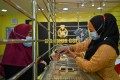 A customer trying on a bracelet at the Makmur Gold shop in Kota Bharu in Malaysia's Kelantan state. Photo: AFP
