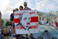 """A man holds a poster reading """"How much more blood will it take?"""" during protests against Belarusian President Alexander Lukashenko in August. Photo: dpa"""