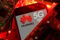 A smartphone with the Huawei and 5G network logo is seen on a PC motherboard in this illustration picture taken January 29, 2020. Photo: Reuters