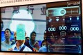 A facial recognition system developed by Tsinghua Unigroup at the first Smart China Expo in Chongqing on August 23, 2018. Unigroup defaulted on a US$450 million keepwell-backed bond. Photo: Reuters