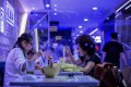 Perspex shields separate diners at a restaurant in Hong Kong on November 25, in the early days of the fourth wave of the Covid-19 pandemic in the city. Photo: AFP