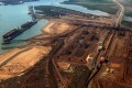 Ships wait to be loaded with iron ore at Port Hedland in the Pilbara region of Western Australia. Photo: Reuters