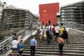 People walk up the steps at a border-crossing facility leading into Shenzhen. Photo: Bloomberg