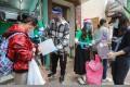 Operation Santa Claus ambassador Pakho Chau helps hand out supplies to Sham Shui Po residents last week. Photo: May Tse