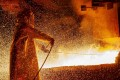 A worker mans a furnace during the nickel-smelting process at a plant in Indonesia. Photo: AFP