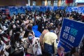 People attend a job fair at the Hongshan Gymnasium in the central Chinse city of Wuhan. Photo: Xinhua