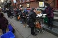 People line up for food at the St Clements Food Pantry in Manhattan, New York City. Photo: Reuters
