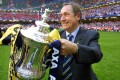 Gerard Houllier with the FA Cup trophy after Liverpool beat Arsenal at the Millennium Stadium in Cardiff in 2001. Photo: AFP