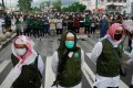 Supporters of Indonesian Muslim cleric Rizieq Shihab gather to protest in Yogyakarta, Indonesia, on Friday. Photo: AFP