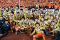 Shandong Luneng players and staff celebrate with the Chinese FA Cup trophy. Photo: Xinhua