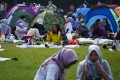 Domestic helpers gather in Victoria Park. Photo: Sam Tsang