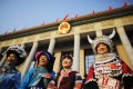 Ethnic minority delegates from Guizhou Province outside the Great Hall of the People in Beijing. Photo: Reuters