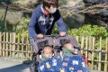 A Japanese father takes his twins out for a stroll. Loved ones willing to share domestic duties can make a world of difference for women struggling to balance family care against demanding jobs, more so during challenges posed by the pandemic. Photo: Shutterstock