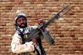 The leader of one of the Boko Haram group's factions, Abubakar Shekau, holds a weapon in an unknown location in Nigeria. Boko Haram Handout / Sahara Reporters via Reuters