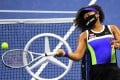 Naomi Osaka, wearing a George Floyd mask, hits balls into the stands on her way to victory at the 2020 US Open. Photo: USA Today