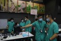 Medical workers help set up a temporary field hospital at the AsiaWorld-Expo in Hong Kong on August 1, during the third wave of the coronavirus pandemic. The city's frontline medical workers are among the 10 nominees for Person of the Year 2020, a contest organised by RTHK's Backchat programme. Photo: AP