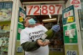 A lottery seller celebrates selling the first prize of Spain's Christmas lottery draw. Photo: AFP