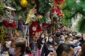 People shop for Christmas decorations at street market in Hong Kong on December 19. Photo: AP