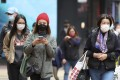 Residents wearing face masks bundle up against the cold in Hong Kong. The city reported 53 new Covid-19 cases on Wednesday, taking the total to 8,353. Photo: Xinhua