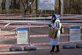 A woman walks past a park closed to prevent spread of the Covid-19 in Seoul. Photo: AFP