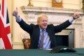 British Prime Minister Boris Johnson tweeted a picture of himself inside No 10 Downing Street, raising both arms in a thumbs-up gesture. Photo: Boris Johnson via Twitter