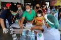 Migrant workers of a seafood market prepare to take a Covid-19 test in Samut Sakhon province. Photo: Reuters