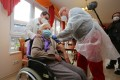 A 101-year old resident of a German retirement home is inoculated on December 27, 2020. Photo: dpa