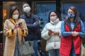 Pedestrians bundled up for cool weather in Hong Kong's Central district. Photo: Xiaomei Chen