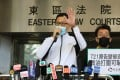 Former Democratic Party lawmaker Lam Cheuk-ting addresses supporters outside the Eastern Magistrates Court on Monday. Photo: Dickson Lee