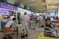 Singaporeans dining at a hawker centre. Photo: Xinhua