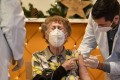 A resident of a nursing home in Cologne, Germany gets an injection. Photo: AP
