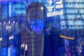 A man looks at the 'Light Of The Internet Expo' during the World Internet Conference in Wuzhen, Zhejiang Province, 23 November 2020. Legislators in the province have introduced the first regional law focusing on public data. Photo: EPA-EFE