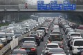 Commute times in Beijing are among the worst in China, with many residents sitting in traffic for hours every day. Photo: AFP