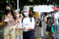 People seen in face masks and face shields in Manila. Photo: Reuters