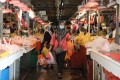 Shoppers at a wet market in Kuala Lumpur. Photo: Reuters