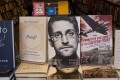 """Copies of the book """"Permanent Record"""" by Edward Snowden are displayed on the shelves at the Harvard Book Store in Massachusetts in September 2019. Snowden has been living in exile in Russia after leaking American intelligence secrets in 2013, and is wanted in the US on espionage charges. Photo: EPA-EFE"""