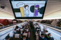 A promotional video about the quiet carriage is played on a Beijing-Shanghai high-speed train, which links the two cities in China. Photo: Wang Xiang