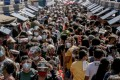 Shoppers were out in force in Manila on Christmas Eve despite the threat of coronavirus transmission. Photo: AFP