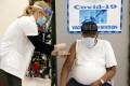 A man receives the Pfizer-BioNTech coronavirus vaccine in Brooklyn, New York. Photo: Reuters