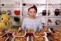 """Mizijun, a female vlogger previously known as Big Stomach Mizijun and one of the pioneers of mukbang, or binge-eating, in China, about to attempt to eat a large quantity of """"Chizza"""" chicken pizza from KFC in a video from her YouTube channel. Photo: YouTube / Mizijun"""