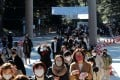 Japanese in protective masks walk to pray on the first day of the new year at the Meiji Shrine in Tokyo, Japan, on Friday. Photo: Reuters