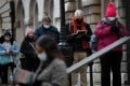 People wait to receive a Covid-19 shot at a vaccination centre in London. Photo: Reuters