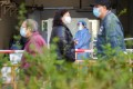 Residents queue for Covid-19 testing at a specimen collection station at Ping Shek Estate following a number of confirmed cases there. Photo: Winson Wong