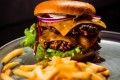 Dishes like this white truffle double cheeseburger may be delicious, but they are unlikely to make you feel as full as an unprocessed meal. Photo: @emanuelekstrom/Unsplash