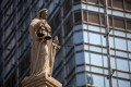 A statue of Lady Justice sits on top of the Court of Final Appeal in Hong Kong. Photo: EPA-EFE