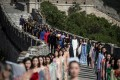 Models walk along the Great Wall of China during the Pierre Cardin China Legend 40th Anniversary Fashion Show on the outskirts of Beijing in 2018. French fashion designer Cardin was revered in China. Photo: AFP