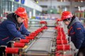 Employees work on a production line at a factory in Jiangsu on Monday. Photo: AFP