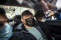 Opposition activist Benny Tai is taken to Ma On Shan Police Station after his arrest. Photo: Bloomberg
