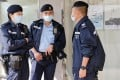 Police stand guard outside the office of one of the arrested, district councillor Lester Shum, on Wednesday. Photo: Reuters