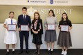 (From left) Student of the Year Awards winners Chloe Yeung, Raymond Yeung, Mary To, and Chan Tsz-kiu along with Judge Irene Chan (centre), head of public affairs at the Hong Kong Jockey Club. Photo: Kwok Wing-hei